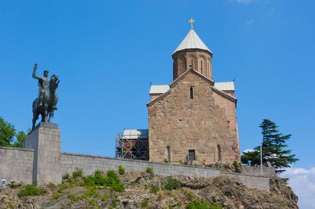 Tbilisi, Georgia - August 7,2013: Virgin Mary Metekhi church with Vakhtang I Gorgasali statue in Tbilisi, Georgia