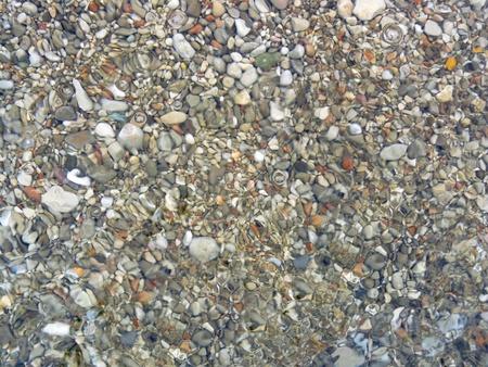Sea pebbles under water photo