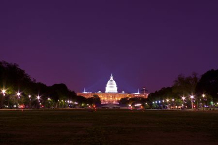 US Capitol Building With National Mall in Foreground At Night Фото со стока