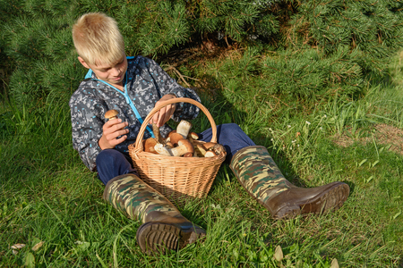 basketful: Teenager with a basketful of forest mushrooms