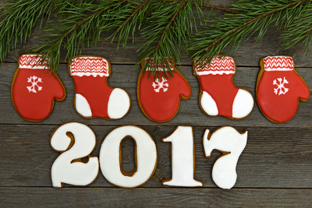 New year 2017, Christmas gingerbreads wooden background Stock Photo