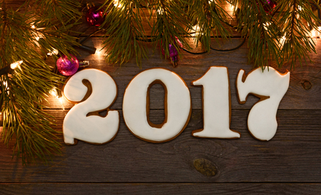New year , Christmas gingerbreads wooden background