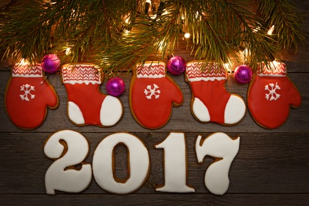 New year 2017 , Christmas gingerbreads wooden background
