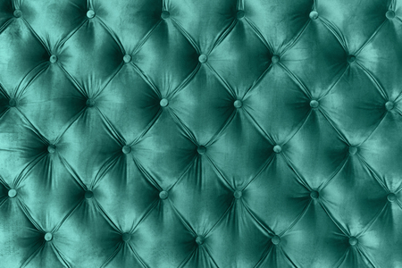 Blue velvet capitone textile background, retro Chesterfield style