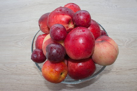 detoxing: Beautiful sweet peaches, nectarine and plums. Ripe fruit on the table