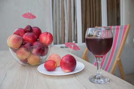 velvety: Beautiful sweet peaches, nectarine and plums. A glass of red wine