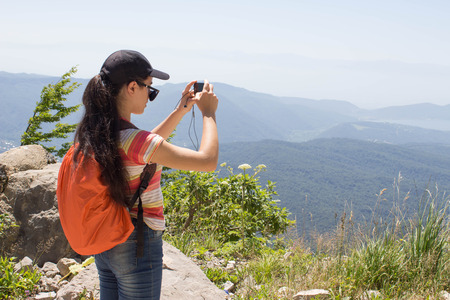 Friends Taking Selfie at Top in Mountain. Healthy girl hiker taking selfie with smart phone. Hiker taking a selfie while out trekking in the mountain