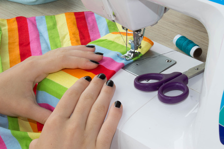 womens hands: Sewing Process , the sewing machine sew womens hands. sewing machine and female scissors. Womans Hand Sewing Quilt