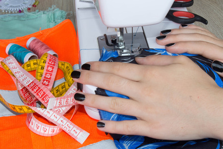 womans hand: Sewing Process , the sewing machine sew womens hands sewing machine. sewing machine and female scissors. Womans Hand Sewing Quilt