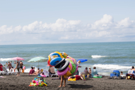 Beach life, holidaymaker at the beach of the image desired blur. Travel or sea vacations concept