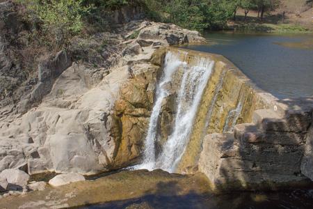 Waterfall is a scenic waterfall located in Georgia. Perfect view waterfall in sunlight Stock Photo
