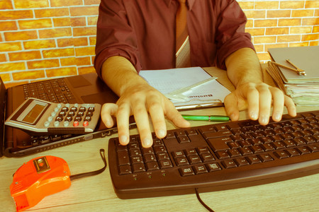 Administrator business man financial inspector making report, calculating or check balance. Internal Revenue Service inspector checking document. Audit concept. male hands in office - Retro color Stock Photo