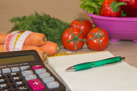 Fresh vegetables, measuring tape with diet plan. Healthy food marketing. Dieting concept. Healthy Food