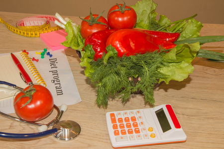 Measure tape and fresh fruit in the background. Healthy lifestyle diet with fresh fruits. Fruit dieting