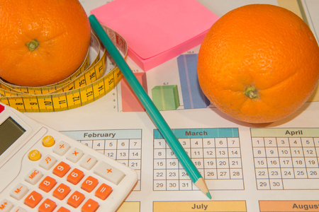Citrus fruits. Measure tape and fresh fruit in the background. Healthy lifestyle diet with fresh fruits