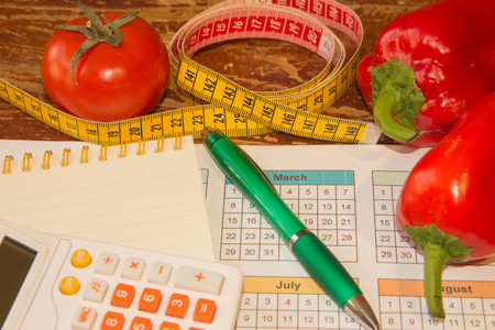 Measure tape and fresh fruit. Healthy lifestyle diet with fresh fruits. Low-calorie fruit diet. Diet for weight loss Stock Photo