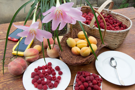 fresh and organic fruits on wooden table,  group of products. Assortment of juicy fruits on wooden table