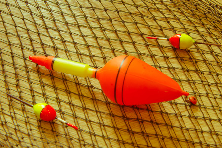 fishing tackles and fishing gear on on the table. Fishing equipment on wooden background 写真素材