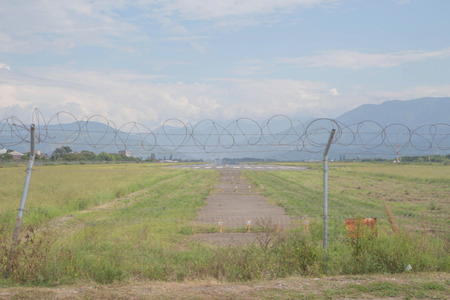 Security fence of an international airport. Fence around restricted area