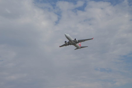 Huge plane taking off in a blue sky closeup. airplane flying above after take off