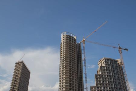 Crane and building construction. big building construction. Tower cranes against the building under construction