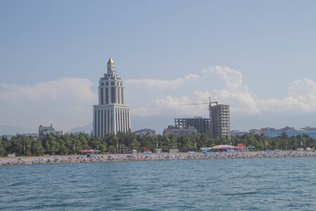 Seaside promenade Georgian Resort Town Of Batumi. View of the embankment of the city from the sea Фото со стока
