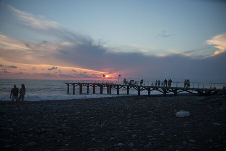 sun setting over Terrace dock or pier. Dock (pier) sea and cloudy sky background. sunset Stock fotó