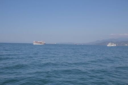 Motor boat in amazing colorful water of Georgia Batumi. Image of Sea view 스톡 콘텐츠