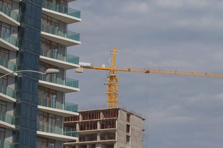 Construction of houses. Working time is under construction. building under construction