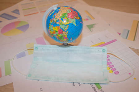 Flu and cold symptoms. Coronavirus Medical mask and globe. Surgical protective mask