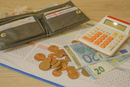 Business, finance, saving money or investment. coin, a calculator on the business papers. Financial saving concept