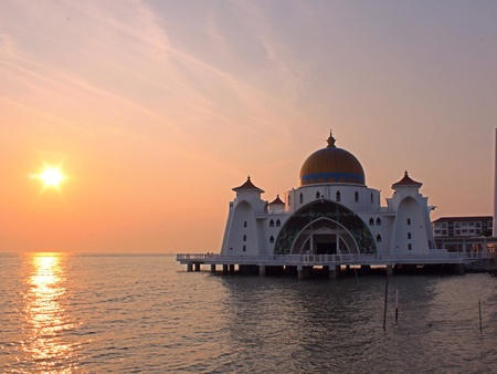 straits: View of sunset at malacca straits mosque