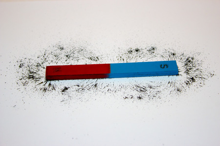magnetic north: Bar magnet. Iron filings show magnetic field lines.