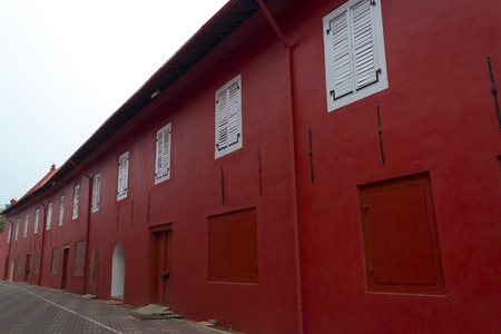 Red and white color painted at timber doors and windows of the historical building in Melaka city, Malaysia. photo