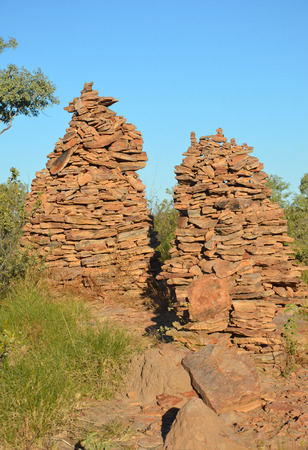 manmade: Rock cairns (man-made stone stacks) under blue skies in outback Queensland, Australia