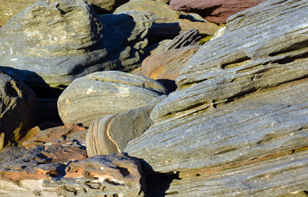 varied: Varied patterns, colours, shapes and layers of natural weathered sandstone rocks on the Sydney coast, New South Wales, Australia