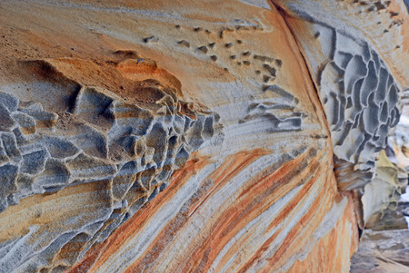 Varied patterns, colours, shapes and layers of natural weathered sandstone on the Sydney coast, New South Wales, Australia Stock Photo