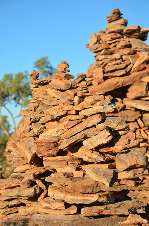 manmade: Close up of rock cairns (man-made stone stacks) under blue skies in outback Queensland, Australia