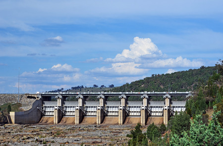 Radial Spillway gates of Wyangala Dam at the junction of the Lachlan and Abercrombie Rivers, central west region, New South Wales, Australia. Built for flood mitigation, hydroelectricity and to supply water for irrigation of agriculture in the Lachlan Valley.