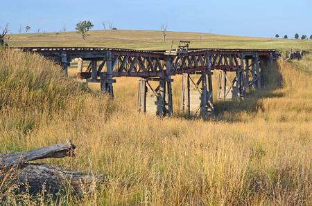 Old abandoned wooden railway bridge near Boorowa, central west NSW, Australia