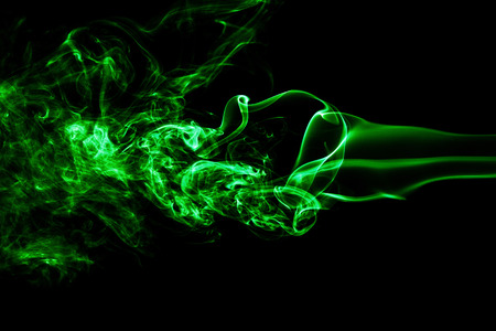 Green colored smoke on a black background. Beautiful background
