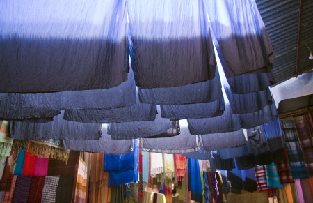 silk wool: Dyed cloth hanging up to dry Stock Photo