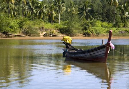 Boat on a tidal river, Khao Lak, Thailand photo