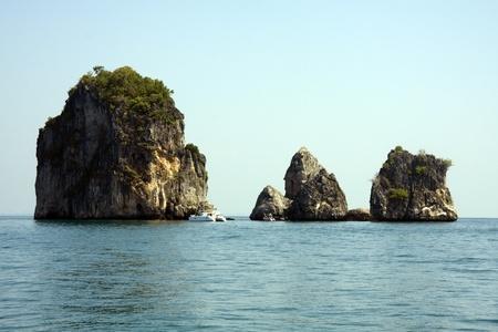 Catamaran and limestone outcrops, Krabi, Thailand Stock Photo - 8897144