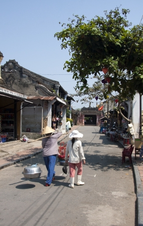 non la: Street Scene, Hoi An, Vietnam Editorial