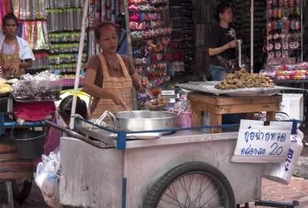 arrests: BANGKOK, THAILAND - SEPT 17TH  A street vendor in Chinatown on September 17th 2012  Authorities are seeking cooperation  of vendors operating illegally instead of arrests and fines  Editorial