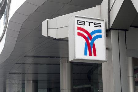 public company: BANGKOK, THAILAND - SEPT 25TH  BTS sign outside Asoke Skytrain station on September 25th 2012  BTS, who operates the Skytrain,  stands for Bangkok Mass Transport System Public Company Limited