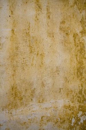 ochre: Grunge wall background - ochre colour