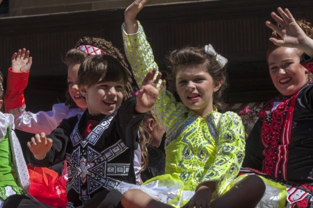 SYDNEY, AUSTRALIA - Mar 17TH  Children waving during the  St Patrick Stock Photo - 20212064