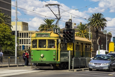 tramcar: MELBOURNE, AUSTRALIA - MAR 20TH  A city circle tram waits at a stop light on March 20th 2013  The tram line is a free service that runs through the Central Business District